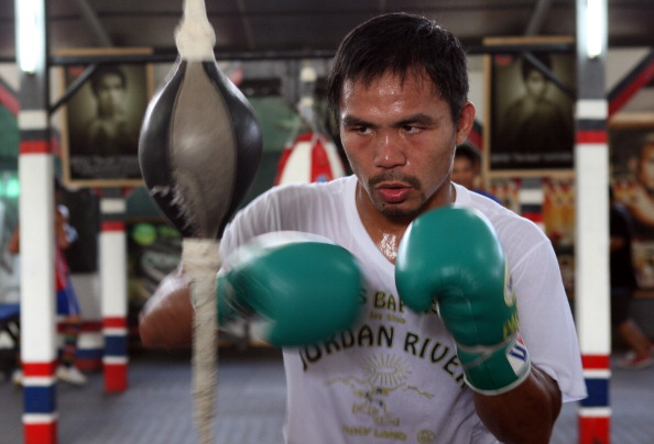 GENERAL SANTOS, PHILIPPINES - SEPTEMBER 27:  Manny Pacquiao in action during a training session at Golingan Gymnasium on September 27, 2012 in General Santos, Philippines. Pacquiao will take on Mexican Juan Manual Marquez on December 8, 2012 in Las Vegas.  (Photo by Jeoffrey Maitem/Getty Images)