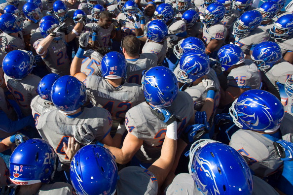 BOISE, ID - OCTOBER 13:  Tommy Smith #33 of the Boise State Broncos pysches up his team in a huddle before the game against the Fresno State Bulldogs at Bronco Stadium on October 13, 2012 in Boise, Idaho.  (Photo by Otto Kitsinger III/Getty Images)