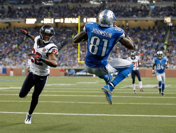 DETROIT, MI - NOVEMBER 22:  Calvin Johnson #81 of the Detroit Lions makes a second quarter touchdown catch behind the defense of Alan Ball #22 of the Houston Texans at Ford Field on November 22, 2012 in Detroit, Michigan. (Photo by Gregory Shamus/Getty Images)