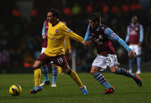 BIRMINGHAM, ENGLAND - NOVEMBER 24:  Santi Cazorla of Arsenal is pulled back by Ashley Westwood of Aston Villa during the Barclays Premier League match between Aston Villa and Arsenal at Villa Park on November 24, 2012 in Birmingham, England.  (Photo by Julian Finney/Getty Images)