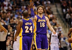Nov 24, 2012; Dallas, TX, USA; Los Angeles Lakers shooting guard Kobe Bryant (24) and power forward Pau Gasol (16) celebrate during the first half against the Dallas Mavericks at the American Airlines Center. Mandatory Credit: Jerome Miron-US PRESSWIRE