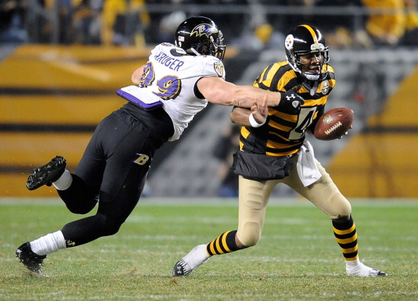 PITTSBURGH, PA - NOVEMBER 18 :  Byron Leftwich #4 of the Pittsburgh Steelers avoids being sacked by Paul Kruger #99 of the Baltimore Ravens on November 18, 2012 at Heinz Field in Pittsburgh, Pennsylvania.  (Photo by Joe Sargent/Getty Images)