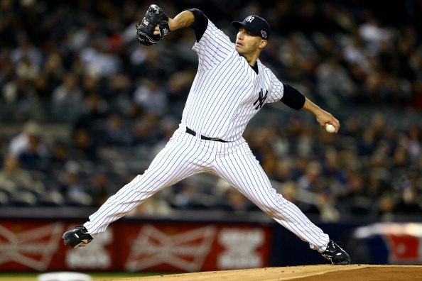 NEW YORK, NY - OCTOBER 13:  Andy Pettitte #46 of the New York Yankees throws a pitch against the Detroit Tigers  during Game One of the American League Championship Series at Yankee Stadium on October 13, 2012 in the Bronx borough of New York City, New York.  (Photo by Al Bello/Getty Images)
