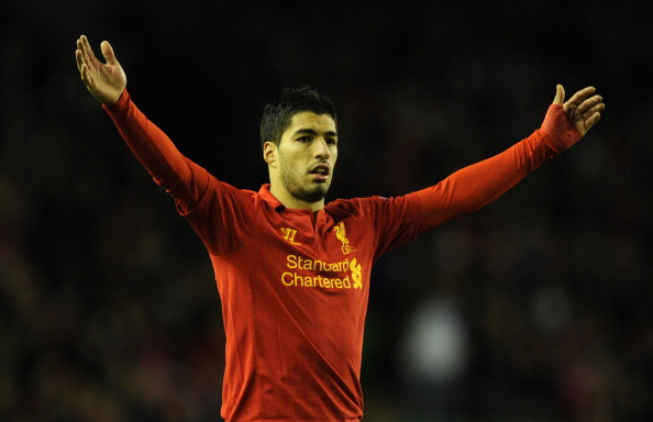 LIVERPOOL, ENGLAND - NOVEMBER 22:  Luis Suarez of Liverpool gestures during the UEFA Europa League Group A match between Liverpool FC and BSC Young Boys at Anfield on November 22, 2012 in Liverpool, England.  (Photo by Chris Brunskill/Getty Images)