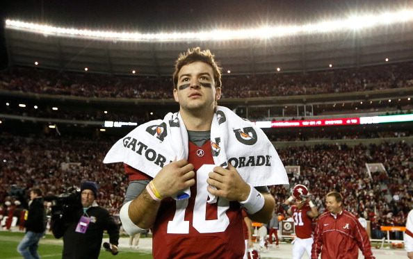TUSCALOOSA, AL - NOVEMBER 24:  AJ McCarron #10 of the Alabama Crimson Tide runs onto the field after their 49-0 win over the Auburn Tigers at Bryant-Denny Stadium on November 24, 2012 in Tuscaloosa, Alabama.  (Photo by Kevin C. Cox/Getty Images)