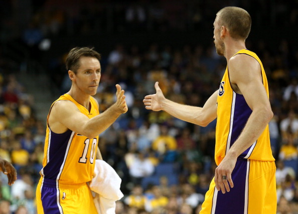 ONTARIO, CA - OCTOBER 10:  Steve Nash #10 of the Los Angeles Lakers greets Steve Blake #5 in the game against the Portland Trail Blazers at Citizens Business Bank Arena on October 10, 2012 in Ontario, California. NOTE TO USER: User expressly acknowledges and agrees that, by downloading and or using this photograph, User is consenting to the terms and conditions of the Getty Images License Agreement.  (Photo by Stephen Dunn/Getty Images)