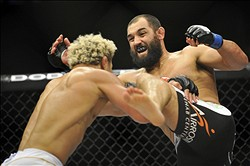 May 5, 2012; East Rutherford, NJ, USA;   Johny Hendricks (right) fights Josh Koscheck in a welterweight bout during UFC on Fox 3 at the Izod Center. Johny Hendricks won by split decision in the third round. Mandatory Credit: Joe Camporeale-US PRESSWIRE