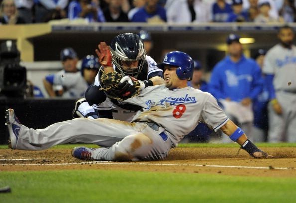 SAN DIEGO, CA - SEPTEMBER 25:  Shane Victorino #8 of the Los Angeles Dodgers is tagged out at the plate by Yasmani Grandal #12 of the San Diego Padres as he tries to score during the second inning of a baseball game at Petco Park on September 25, 2012 in San Diego, California.  (Photo by Denis Poroy/Getty Images)