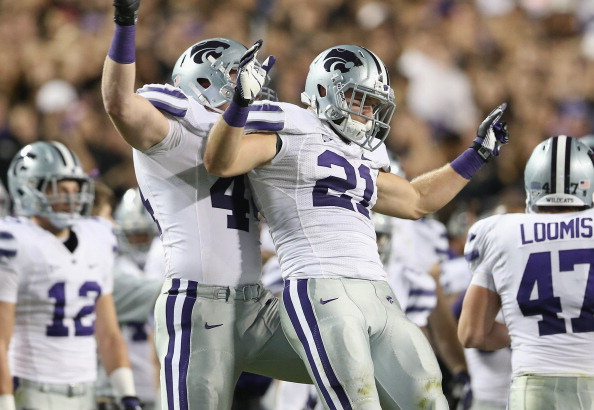 FORT WORTH, TX - NOVEMBER 10:  Jonathan Truman #21 of the Kansas State Wildcats celebrates his fumble recovery against the TCU Horned Frogs with Ryan Mueller #44 at Amon G. Carter Stadium on November 10, 2012 in Fort Worth, Texas.  (Photo by Ronald Martinez/Getty Images)