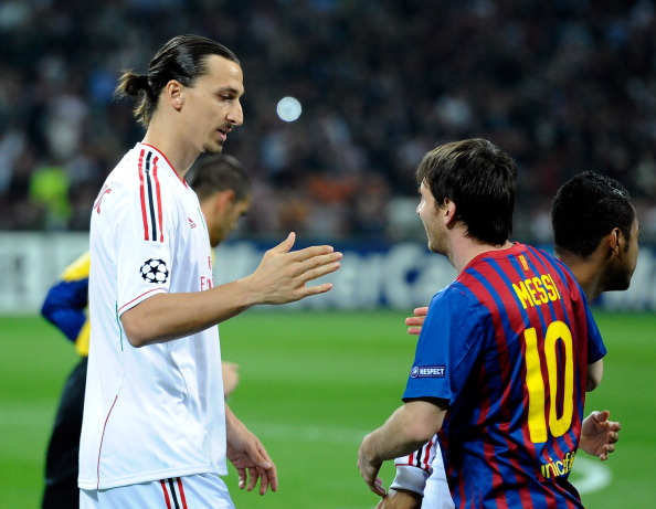 MILAN, ITALY - MARCH 28:  Zlatan Ibrahimovic of AC Milan and Lionel Messi of Barcelona during the UEFA Champions League quarter final first leg match between AC Milan and Barcelona at Stadio Giuseppe Meazza on March 28, 2012 in Milan, Italy.  (Photo by Claudio Villa/Getty Images)