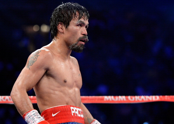 LAS VEGAS, NV - JUNE 09:  Manny Pacquiao stands in the ring during his fight against Timothy Bradley at MGM Grand Garden Arena on June 9, 2012 in Las Vegas, Nevada.  (Photo by Kevork Djansezian/Getty Images)