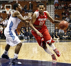 Nov 17, 2012; Uncasville, CT, USA; Ohio State Buckeyes forward LaQuinton Ross (10) drives to the hoop against Rhode Island Rams guard Mike Powell (left) during the first half at Mohegan Sun Arena.  Mandatory Credit: Mark L. Baer-US PRESSWIRE