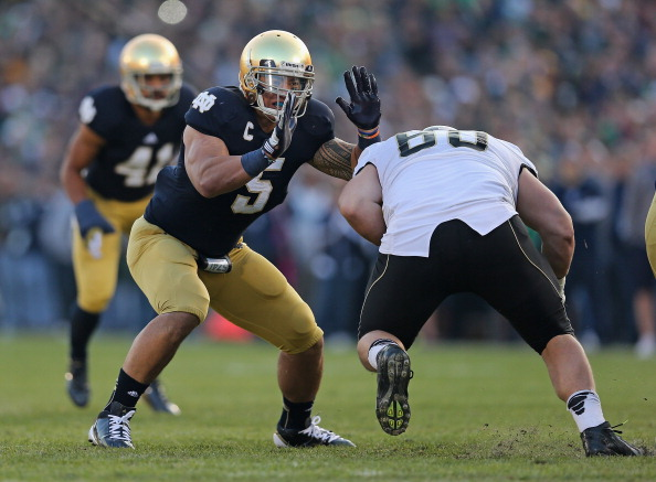 SOUTH BEND, IN - NOVEMBER 17: Manti T'eo #5 of the Notre Dame Fighting Irish moves around Whit Barnes #60 of the Wake Forest Demon Deacons at Notre Dame Stadium on November 17, 2012 in South Bend, Indiana. Notre Dame defeated Wake Forest 38-0.  (Photo by Jonathan Daniel/Getty Images)