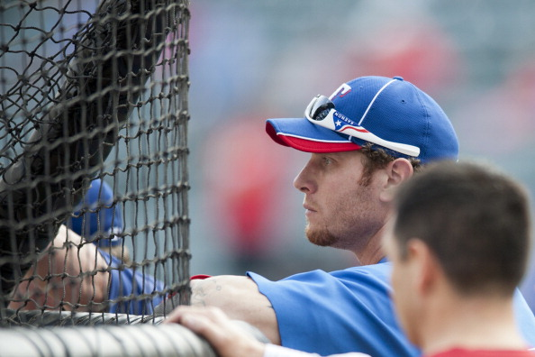 ARLINGTON, TX - OCTOBER 5:  Josh Hamilton #32 of the Texas Rangers looks on during during batting practice before the American League Wild Card game against the /TEAM on October 5, 2012 at the Rangers Ballpark in Arlington, Texas.  (Photo by Cooper Neill/Getty Images)