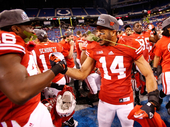 INDIANAPOLIS, IN - DECEMBER 01: Marcus Cromartie #14 of the Wisconsin Badgers celebrates a 70-31 win over the Nebraska Cornhuskers in the Big 10 Conference Championship Game at Lucas Oil Stadium on December 1, 2012 in Indianapolis, Indiana.  (Photo by Gregory Shamus/Getty Images)