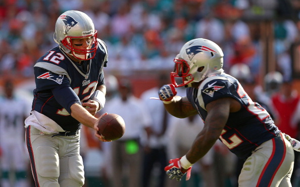 MIAMI GARDENS, FL - DECEMBER 02:  Tom Brady #12 of the New England Patriots hands off to Stevan Ridley #22 during a game against the Miami Dolphins at Sun Life Stadium on December 2, 2012 in Miami Gardens, Florida.  (Photo by Mike Ehrmann/Getty Images)