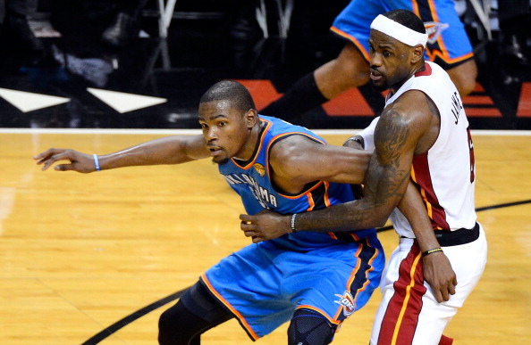 MIAMI, FL - JUNE 19:  Kevin Durant #35 of the Oklahoma City Thunder fighte for position against LeBron James #6 of the Miami Heat in Game Four of the 2012 NBA Finals on June 19, 2012 at American Airlines Arena in Miami, Florida. NOTE TO USER: User expressly acknowledges and agrees that, by downloading and or using this photograph, User is consenting to the terms and conditions of the Getty Images License Agreement.  (Photo by Ronald Martinez/Getty Images)