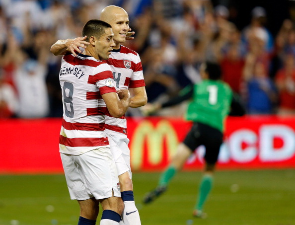 KANSAS CITY, KS - OCTOBER 16:  Michael Bradley #4 of the USA congratulates Clint Dempsey #8 after Dempsey scored a goal during the first half fo the World Cup Qualifying match against Guatemala at LiveStrong Sporting Park on October 16, 2012 in Kansas City, Kansas.  (Photo by Jamie Squire/Getty Images)