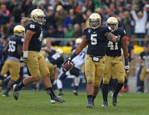 SOUTH BEND, IN - OCTOBER 20:  Manti T'eo #5 of the Notre Dame Fighting Irish celebrates with Dan Fox #48 (L) and Matthias Farley #41 after intercepting a pass against of the BYU Cougars at Notre Dame Stadium on October 20, 2012 in South Bend, Indiana. Niotre Dame defeated BYU 17-14.  (Photo by Jonathan Daniel/Getty Images)