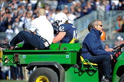 Nov 17, 2012; University Park, PA, USA; Penn State Nittany Lions linebacker Michael Mauti (42) is taken off the field after being injured during the first quarter against the Indiana Hoosiers at Beaver Stadium.  Mandatory Credit: Rich Barnes-USA TODAY Sports