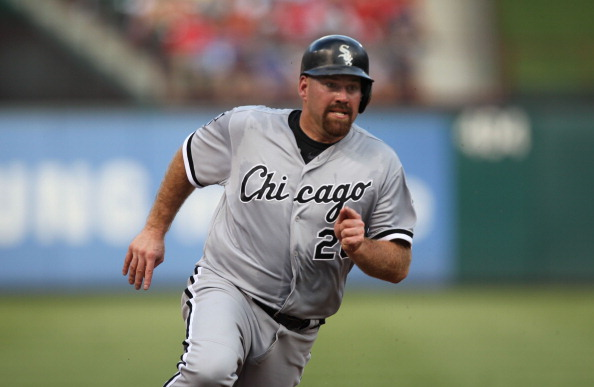 ARLINGTON, TX - JULY 27: Kevin Youkilis #20 of the Chicago White Sox rounds 3rd base and heads for home against the Texas Rangers on July 27, 2012 at the Rangers Ballpark in Arlington in Arlington, Texas. (Photo by Layne Murdoch/Getty Images)