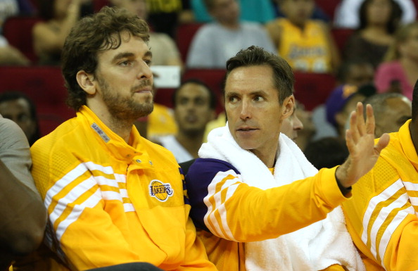 FRESNO, CA - OCTOBER 07:  Pau Gasol #16 (L) and Steve Nash #10 of the Los Angeles Lakers talk on the bench during the second half of the game with the Golden State Warriors at Save Mart Center At Fresno State on October 7, 2012 in Fresno, California.  The Warriors won 110-83.  NOTE TO USER: User expressly acknowledges and agrees that, by downloading and or using this photograph, User is consenting to the terms and conditions of the Getty Images License Agreement.  (Photo by Stephen Dunn/Getty Images)