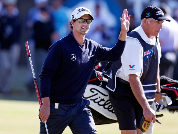 MELBOURNE, AUSTRALIA - NOVEMBER 18:  Adam Scott of Australia waves to the crowd on the 18th hole during day four of the Australia Masters at Kingston Heath Golf Club on November 18, 2012 in Melbourne, Australia.  (Photo by Michael Dodge/Getty Images)