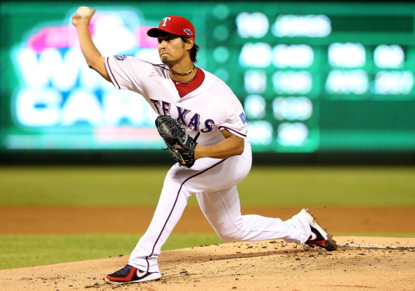 ARLINGTON, TX - OCTOBER 05:  Yu Darvish #11 of the Texas Rangers throws a pitch against the Baltimore Orioles during the American League Wild Card playoff game  at Rangers Ballpark in Arlington on October 5, 2012 in Arlington, Texas.  (Photo by Ronald Martinez/Getty Images)