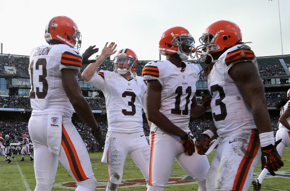 OAKLAND, CA - DECEMBER 02:  Brandon Weeden #3 congratulates Josh Gordon #13 of the Cleveland Browns after Gordon caught a touchdown pass during their game against the Oakland Raiders at O.co Coliseum on December 2, 2012 in Oakland, California.  (Photo by Ezra Shaw/Getty Images)