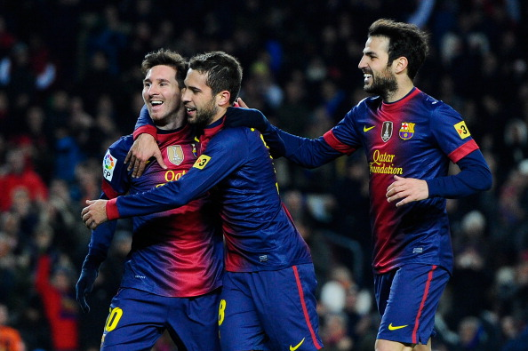 BARCELONA, SPAIN - DECEMBER 01:  Lionel Messi of FC Barcelona celebrates with his teammate Jordi Alba (C) and Cesc Fabregas after scoring his team's fifth goal during the La Liga match between FC Barcelona and Athletic Club at Camp Nou on December 1, 2012 in Barcelona, Spain.  (Photo by David Ramos/Getty Images)