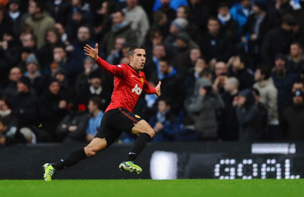 MANCHESTER, ENGLAND - DECEMBER 09:  Robin van Persie of Manchester United celebrates scoring the winning goal during the Barclays Premier League match between Manchester City and Manchester United at the Etihad Stadium on December 9, 2012 in Manchester, England.  (Photo by Laurence Griffiths/Getty Images)