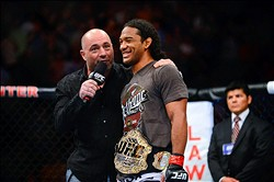 August 11, 2012; Denver, CO, USA; UFC host Joe Rogan (left) talks with Benson Henderson (right) after he defeated Frankie Edgar (not pictured) during UFC 150 at the Pepsi Center. Mandatory Credit: Ron Chenoy-USA TODAY Sports
