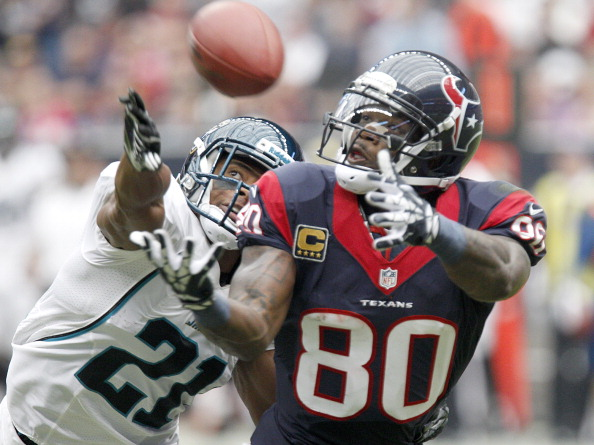 HOUSTON, TX- NOVEMBER 18: Andre Johnson #80 of the Houston Texans can't quite make the catch while Derek Cox #21 of the Jacksonville Jaguars defends on November 18, 2012 at Reliant Stadium in Houston, Texas. (Photo by Thomas B. Shea/Getty Images)