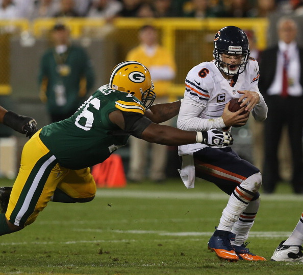GREEN BAY, WI - SEPTEMBER 13:  Jay Cutler #6 of the Chicago Bears tries to escape Mike Daniels #76 of the Green Bay Packers at Lambeau Field on September 13, 2012 in Green Bay, Wisconsin. The Packers defeated the Bears 23-10.  (Photo by Jonathan Daniel/Getty Images)