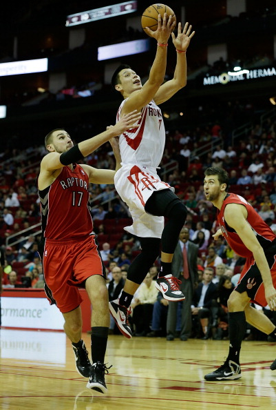 HOUSTON, TX - NOVEMBER 27:  Jeremy Lin #7 of the Houston Rockets drives past  Jonas Valanciunas #17 of the Toronto Raptors at the Toyota Center on November 27, 2012 in Houston, Texas. NOTE TO USER: User expressly acknowledges and agrees that, by downloading and or using this photograph, User is consenting to the terms and conditions of the Getty Images License Agreement.  (Photo by Scott Halleran/Getty Images)