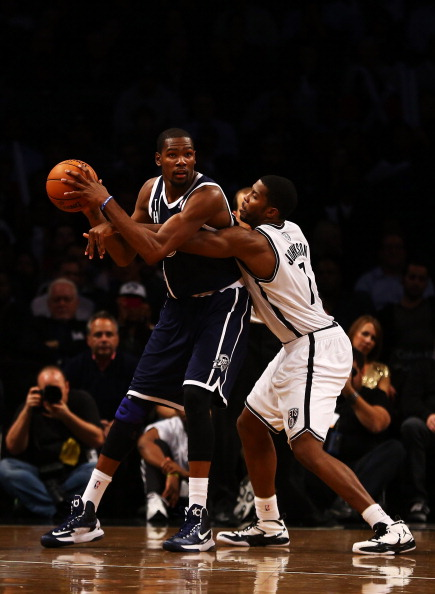NEW YORK, NY - DECEMBER 04:  Kevin Durant #35 of the Oklahoma City Thunder handles the ball as Joe Johnson #7 of the Brooklyn Nets defends during their game at the Barclays Center on December 4, 2012 in the Brooklyn borough of New York City. NOTE TO USER: User expressly acknowledges and agrees that, by downloading and/or using this photograph, user is consenting to the terms and conditions of the Getty Images License Agreement.  (Photo by Al Bello/Getty Images)