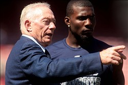 September 18, 2011; San Francisco, CA, USA; Dallas Cowboys owner Jerry Jones talks with wide receiver Dez Bryant before the start of the game against the San Francisco 49ers at Candlestick Park. Mandatory Credit: Cary Edmondson-USA TODAY Sports