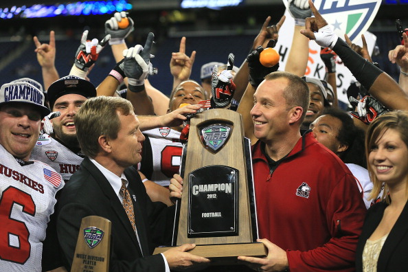 DETROIT, MI - NOVEMBER 30:  Head coach Dave Doeren of the Northern Illinois Huskies is presented the championship trophy by MAC Commissioner, Dr. Jon A. Steinbrecher after defeating the Kent State Golden Flashes 44-37 during the Mid-American Conference Championship game at Ford Field on November 30, 2012 in Detroit, Michigan.  (Photo by Dave Reginek/Getty Images)