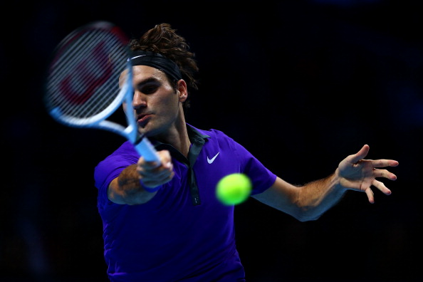 LONDON, ENGLAND - NOVEMBER 12:  Roger Federer of Switzerland returns a shot during his men's singles final match against Novak Djokovic of Serbia during day eight of the ATP World Tour Finals at O2 Arena on November 12, 2012 in London, England.  (Photo by Matthew Lewis/Getty Images)