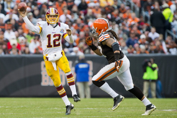CLEVELAND, OH - DECEMBER 16: Quarterback Kirk Cousins #12 of the Washington Redskins passes under pressure from defensive end Jabaal Sheard #97 of the Cleveland Browns during the second half at Cleveland Browns Stadium on December 16, 2012 in Cleveland, Ohio. The Redskins defeated the Browns 38-21. (Photo by Jason Miller/Getty Images)