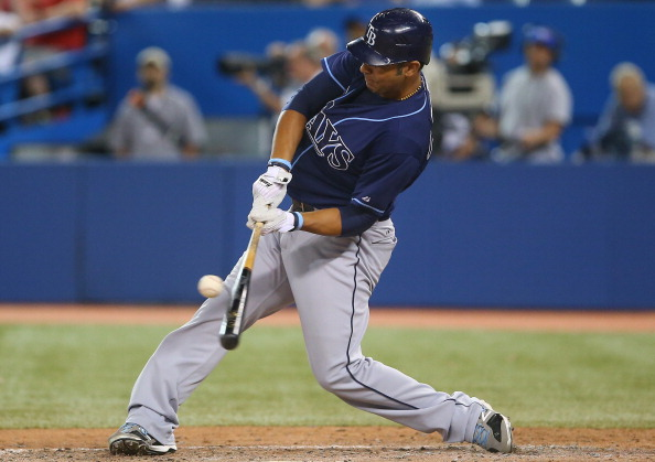 TORONTO, CANADA - AUGUST 31: Carlos Pena #23 of the Tampa Bay Rays hits a single in the ninth inning during MLB game action against the Toronto Blue Jays on August 31, 2012 at Rogers Centre in Toronto, Ontario, Canada. (Photo by Tom Szczerbowski/Getty Images)