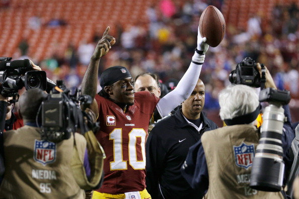 LANDOVER, MD - DECEMBER 03: Quarterback Robert Griffin III #10 of the Washington Redskins celebrates after the Redskins defeated the New York Giants 17-16 at FedExField on December 3, 2012 in Landover, Maryland.  (Photo by Rob Carr/Getty Images)