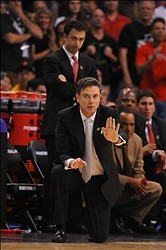 March 24, 2012; Phoenix, AZ, USA; Louisville Cardinals head coach Rick Pitino (bottom) instructs in front of associate coach Richard Pitino (top) during the second half in the finals of the west region of the 2012 NCAA men's basketball tournament against the Florida Gators at US Airways Center. The Cardinals defeated the Gators 72-68.  Mandatory Credit: Christopher Hanewickel-USA TODAY Sports