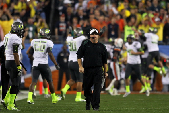 GLENDALE, AZ - JANUARY 10:  Head coach Chip Kelly of the Oregon Ducks waslks down the sideline after his Ducks scored a second quater touchdown against the Auburn Tigers in the Tostitos BCS National Championship Game at University of Phoenix Stadium on January 10, 2011 in Glendale, Arizona.  (Photo by Jonathan Ferrey/Getty Images)