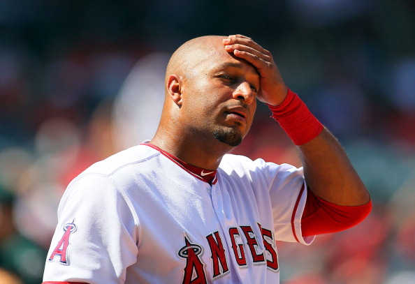 ANAHEIM, CA - SEPTEMBER 13:  Vernon Wells #10 of the Los Angeles Angels of Anaheim wipes his forehead after reaching first base on an infield single during a break in action in the seventh inning of the MLB game against the Oakland Athletics at Angel Stadium of Anaheim on September 13, 2012 in Anaheim, California.  (Photo by Victor Decolongon/Getty Images)