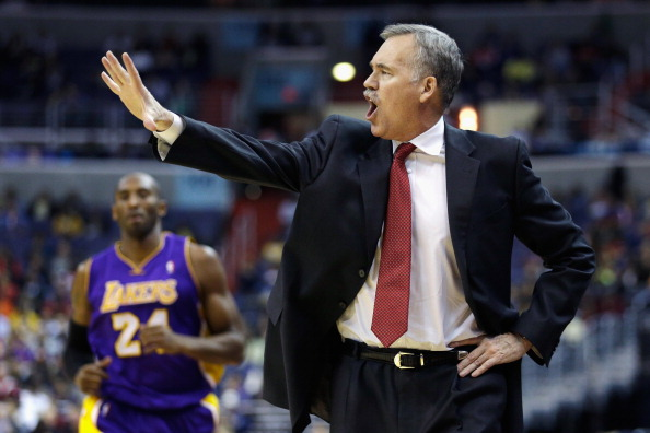 WASHINGTON, DC - DECEMBER 14:  Head coach  Mike D'Antoni of the Los Angeles Lakers motions from the bench as Kobe Bryant #24 comes up the floor against the Washington Wizards at Verizon Center on December 14, 2012 in Washington, DC. NOTE TO USER: User expressly acknowledges and agrees that, by downloading and or using this photograph, User is consenting to the terms and conditions of the Getty Images License Agreement.  (Photo by Rob Carr/Getty Images)