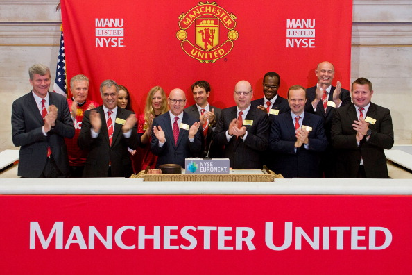 NEW YORK, NY - AUGUST 10:  In this handout photo provided by the NYSE Euronext, Manchester United Executives David Gill (L), Joel Glazer (3rd L) and Avram Glazer (4th L) prepare to ring the Opening Bell at the New York Stock Exchange on August 10, 2012 in New York City. Manchester United shares started trading at USD 14.05 at the opening of the New York Stock Exchange. (Photo Ben Hider/Getty Images via NYSE Euronext)