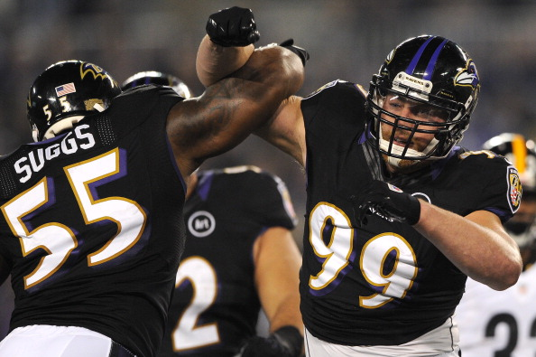 BALTIMORE, MD - DECEMBER 02: Linebacker Paul Kruger #99 of the Baltimore Ravens celebrates with teammate Terrell Suggs #55 after a sack against the Pittsburgh Steelers at M&T Bank Stadium on December 2, 2012 in Baltimore, Maryland. (Photo by Patrick Smith/Getty Images)