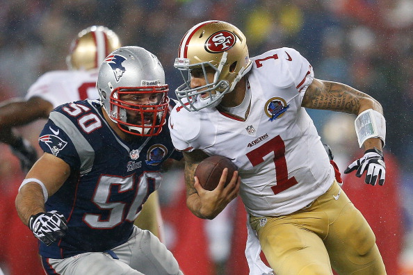 FOXBORO, MA - DECEMBER 16:  Colin Kaepernick #7 of the San Francisco 49ers feels the pressure of Rob Ninkovich #50 of the New England Patriots in the second half at Gillette Stadium on December 16, 2012 in Foxboro, Massachusetts. (Photo by Jim Rogash/Getty Images)