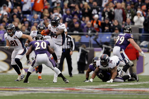 BALTIMORE, MD - DECEMBER 16:  Running back Knowshon Moreno #27 of the Denver Broncos prepares to leap over free safety Ed Reed #20 of the Baltimore Ravens while rushing the ball during the first half at M&T Bank Stadium on December 16, 2012 in Baltimore, Maryland.  (Photo by Rob Carr/Getty Images)